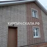 дом из серого кирпича фото