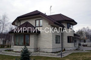 фасад дома из серого кирпича